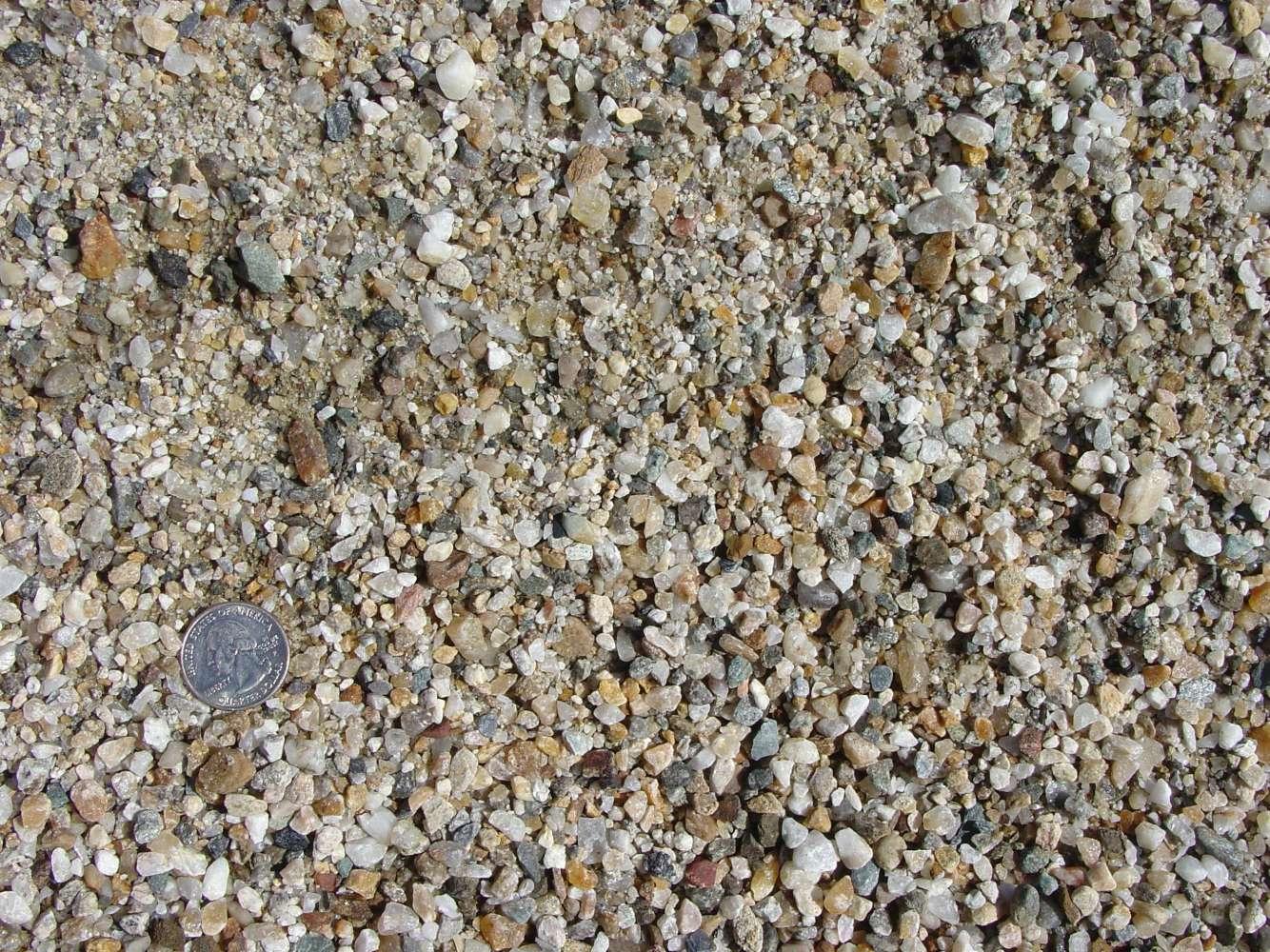 "Washed Crushed Native Stone 1-1/4"" Grit"